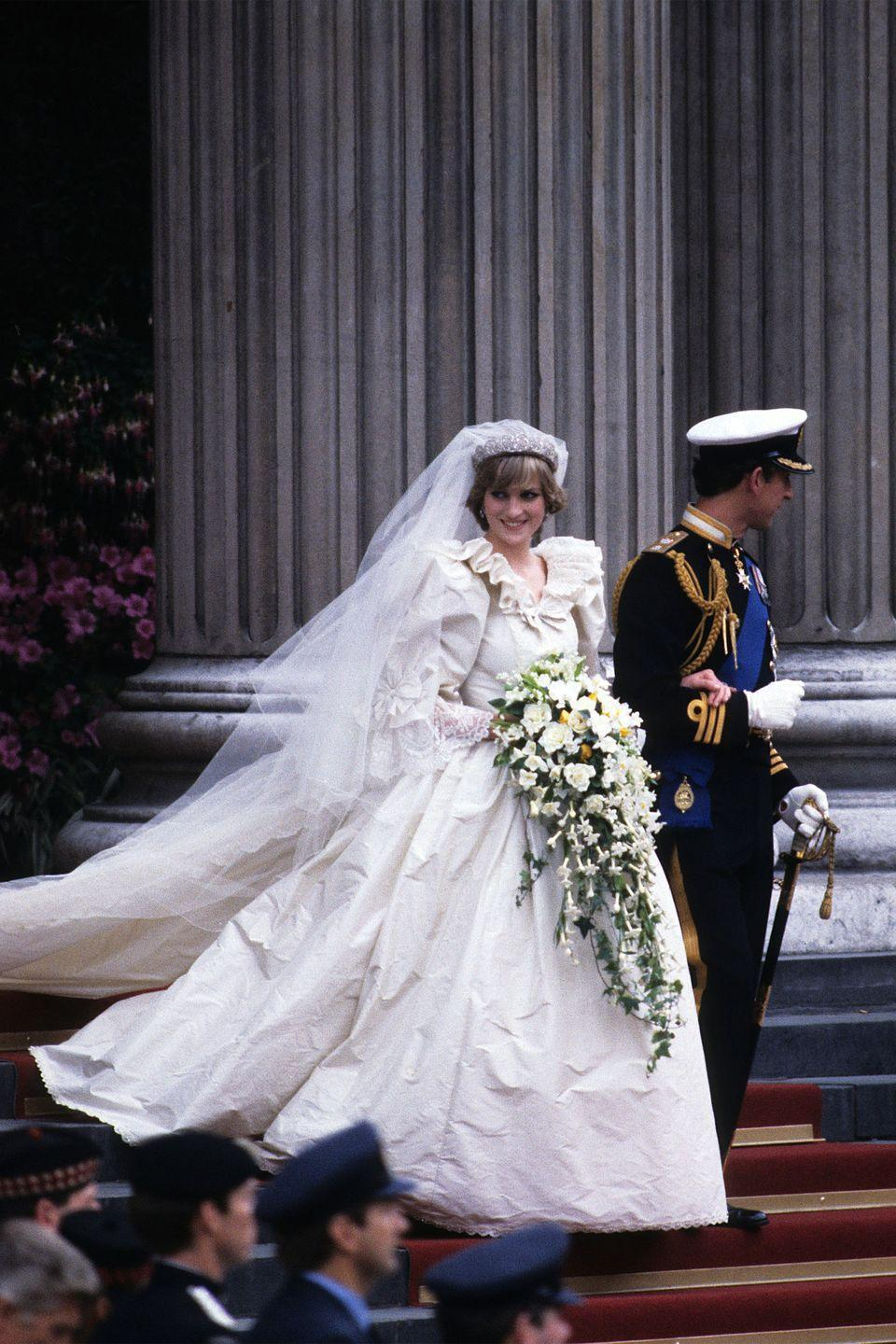 <p>In a wedding dress designed by Emanuel leaving St. Paul's Cathedral with husband Prince Charles on their wedding day in London. </p>