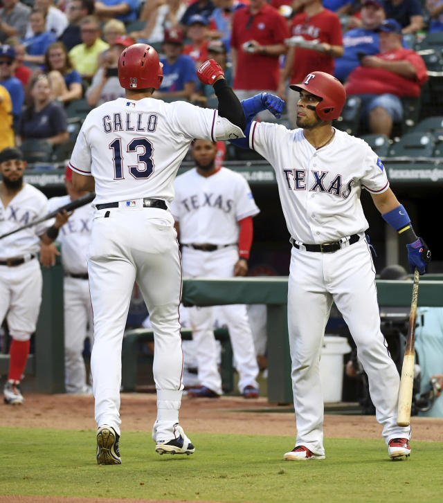 Texas Rangers' Joey Gallo (13) is congratulated by Robinson Chirinos, right, after hitting a solo home run off Los Angeles Angels starting pitcher Taylor Cole during the second inning of a baseball game Thursday, Aug. 16, 2018, in Arlington, Texas. (AP Photo/Jeffrey McWhorter)