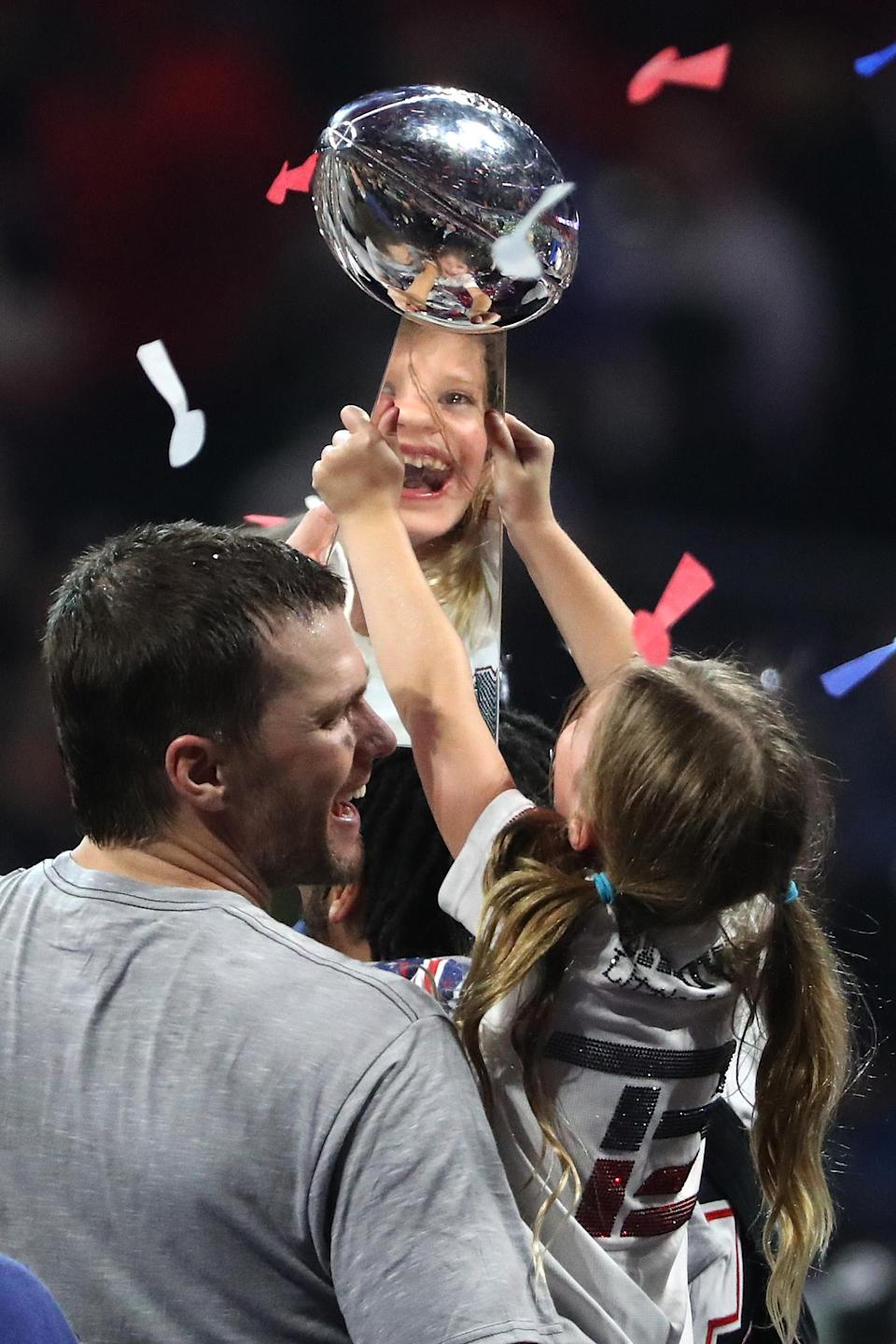<p>Tom Brady #12 of the New England Patriots and Vivian Lake Brady celebrate with the Vince Lombardi trophy after the teams 13-3 win over Los Angeles Rams during Super Bowl LIII at Mercedes-Benz Stadium on February 03, 2019 in Atlanta, Georgia. (Photo by Streeter Lecka/Getty Images) </p>
