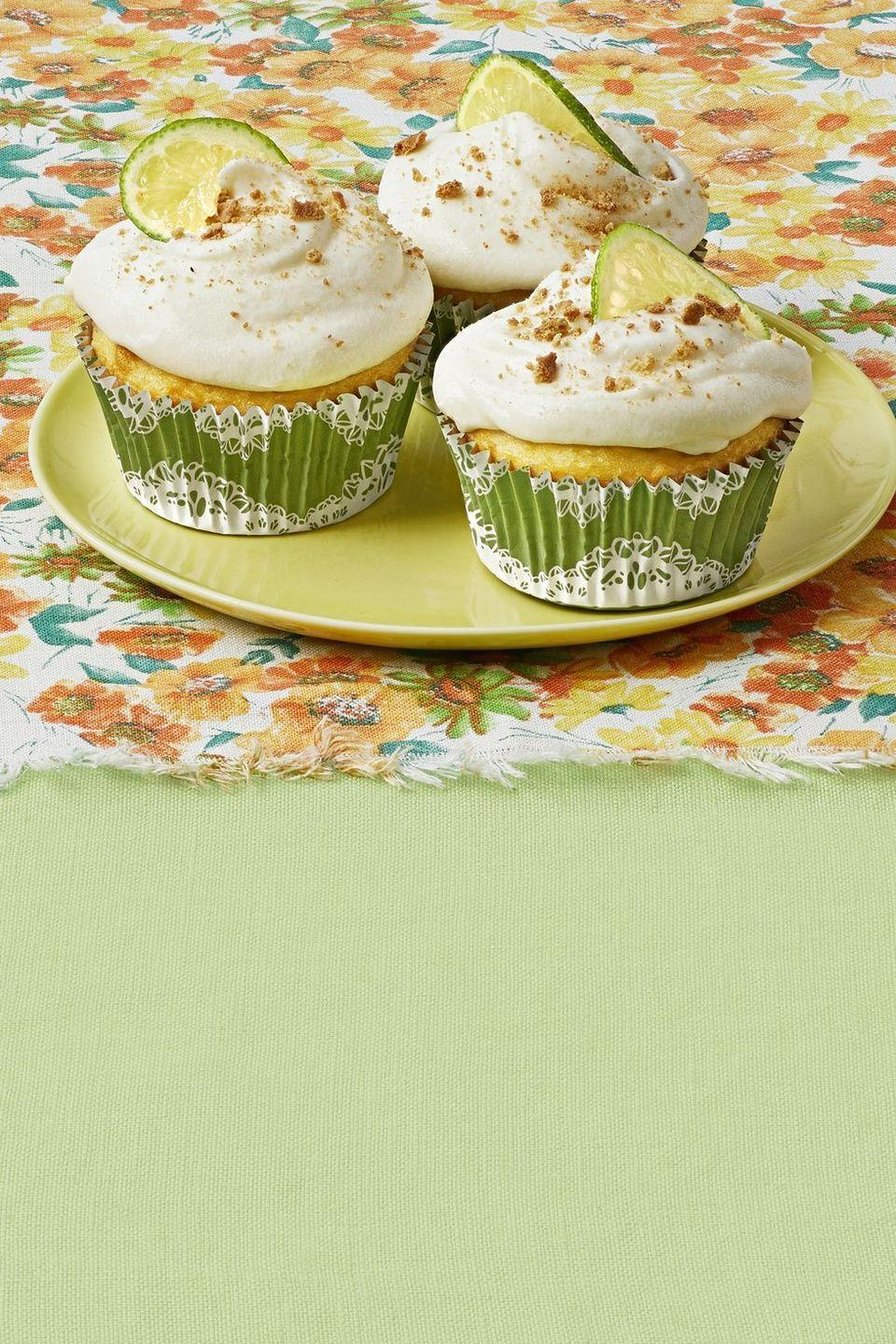 """<p>If you love Key Lime Pie, these cupcakes are for you. Ree starts with a cake mix, then adds a homemade tart lime curd and frosting. </p><p><strong><a href=""""https://www.thepioneerwoman.com/food-cooking/recipes/a32973429/key-lime-pie-cupcakes-recipe/"""" rel=""""nofollow noopener"""" target=""""_blank"""" data-ylk=""""slk:Get Ree's recipe."""" class=""""link rapid-noclick-resp"""">Get Ree's recipe.</a></strong></p><p><a class=""""link rapid-noclick-resp"""" href=""""https://go.redirectingat.com?id=74968X1596630&url=https%3A%2F%2Fwww.walmart.com%2Fsearch%2F%3Fquery%3Dfloral%2Btablecloth%26typeahead%3Dfloral%2Btable&sref=https%3A%2F%2Fwww.thepioneerwoman.com%2Ffood-cooking%2Frecipes%2Fg36343624%2F4th-of-july-cupcakes%2F"""" rel=""""nofollow noopener"""" target=""""_blank"""" data-ylk=""""slk:SHOP FLORAL TABLECLOTHS"""">SHOP FLORAL TABLECLOTHS</a></p>"""