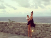 """<p>""""No one told me I would be coming home in diapers too."""" [Photo: Instagram/Chrissyteigen] </p>"""
