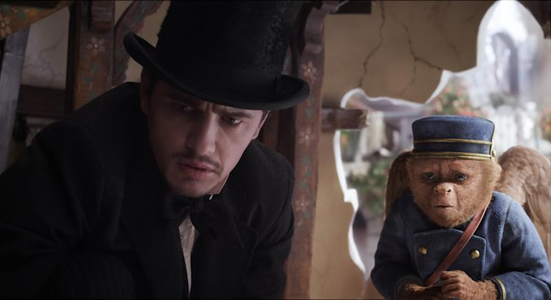 "This film image released by Disney Enterprises shows James Franco, as Oz, left, and the character Finley, voiced by Zach Braff, are shown in a scene from ""Oz the Great and Powerful."" (AP Photo/Disney Enterprises)"
