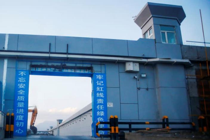 A gate of what is officially known as a vocational skills education centre is photographed in Dabancheng