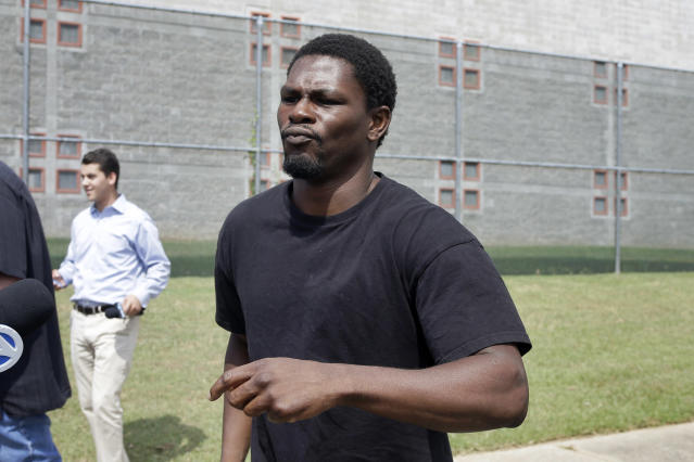 Boxer Jermain Taylor walks from the Pulaski County Jail in Little Rock, Ark., after spending the night there Wednesday, Aug. 27, 2014. Taylor is free on a $25,000 bond after the former middleweight champion was jailed in connection with a shooting that wounded his cousin. (AP Photo/Danny Johnston)