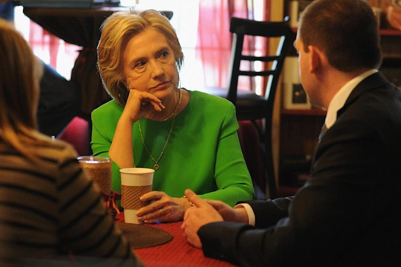 Hillary Clinton has coffee with local residents at the Jones Street Java House during a campaign visit April 14, 2015 in Le Claire, Iowa (AFP Photo/Michael B. Thomas)