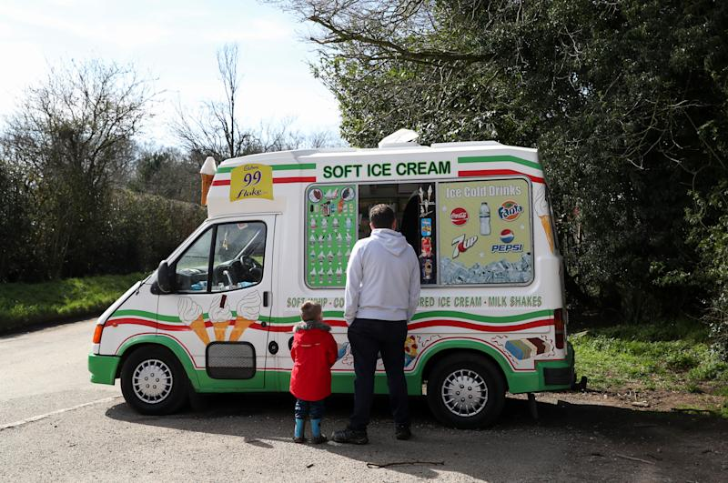 AYLESBURY VALE, ENGLAND - MARCH 22: A family enjoy an ice cream at Coombe Hill on March 22, 2020 in Aylesbury Vale, Buckinghamshire. Coronavirus (COVID-19) has spread to at least 188 countries, claiming over 13,000 lives and infecting more than 300,000 people. There have now been 5,018 diagnosed cases in the UK and 240 deaths. (Photo by Catherine Ivill/Getty Images)