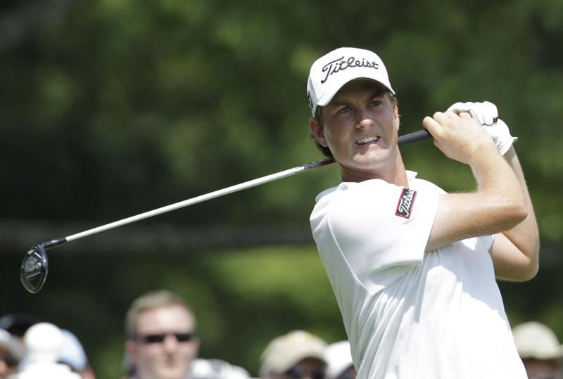 Webb Simpson watches his tee shot on the ninth hole during the second round of the Greenbrier Classic PGA Golf tournament at the Greenbrier in White Sulphur Springs, W. Va., Friday, July 6, 2012. (AP Photo/Steve Helber)