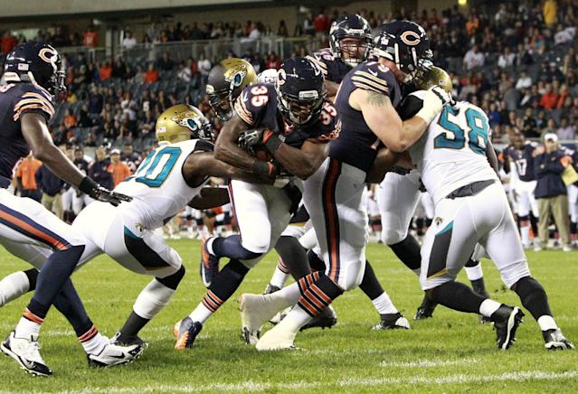 Chicago Bears running back Senorise Perry (35) breaks through to score the go-ahead touchdown against the Jacksonville Jaguars during the second half of an NFL preseason football game in Chicago, Thursday, Aug. 14, 2014. The Bears won 20-19. (AP Photo/Stacy Thacker)