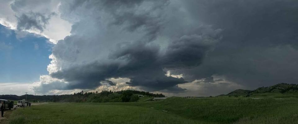 A severe storm over the Black Hills in South Dakota. Rotating supercell thunderstorm with large hail.