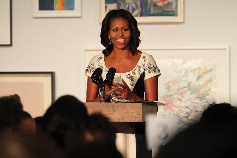 U.S. first lady Michelle Obama speaks during a luncheon at The Studio Museum of Harlem Tuesday Sept. 24, 2013 in New York. The first lady hosted the event for spouses of chiefs of state and heads of government participating in the UN General Assembly. (AP Photo/Tina Fineberg)