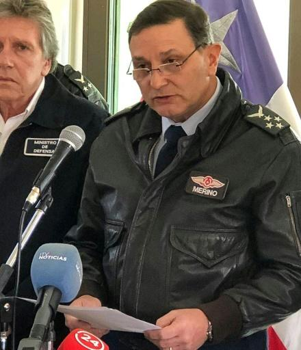 Chilean Air Force General Commander Arturo Merino (R) speaks during a press conference at the Chabunco Military base in Punta Arenas