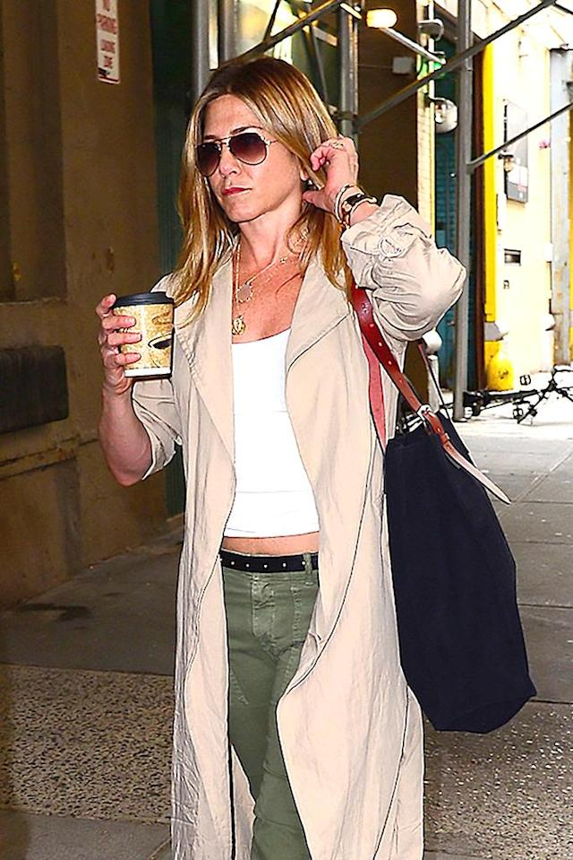 <p>Jennifer looked pretty serious about her coffee here. Hey, we totally get it! (Photo: AKM-GSI) </p>