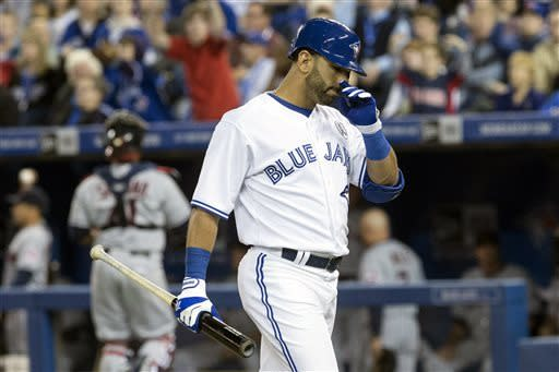 Toronto Blue Jays' Jose Bautista reacts as he walks off the field after striking out to the Cleveland Indians' Joe Smith during the eighth inning of an opening day baseball game in Toronto on Tuesday, April 2, 2013. (AP Photo/The Canadian Press, Chris Young)