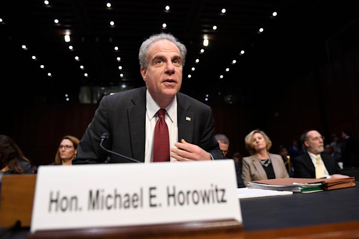 Department of Justice Inspector General Michael Horowitz returns from a break to continue testifying at a Senate Judiciary Committee hearing on Capitol Hill in Washington, Wednesday, Dec. 11, 2019, on the Inspector General's report on alleged abuses of the Foreign Intelligence Surveillance Act. (AP Photo/Susan Walsh)
