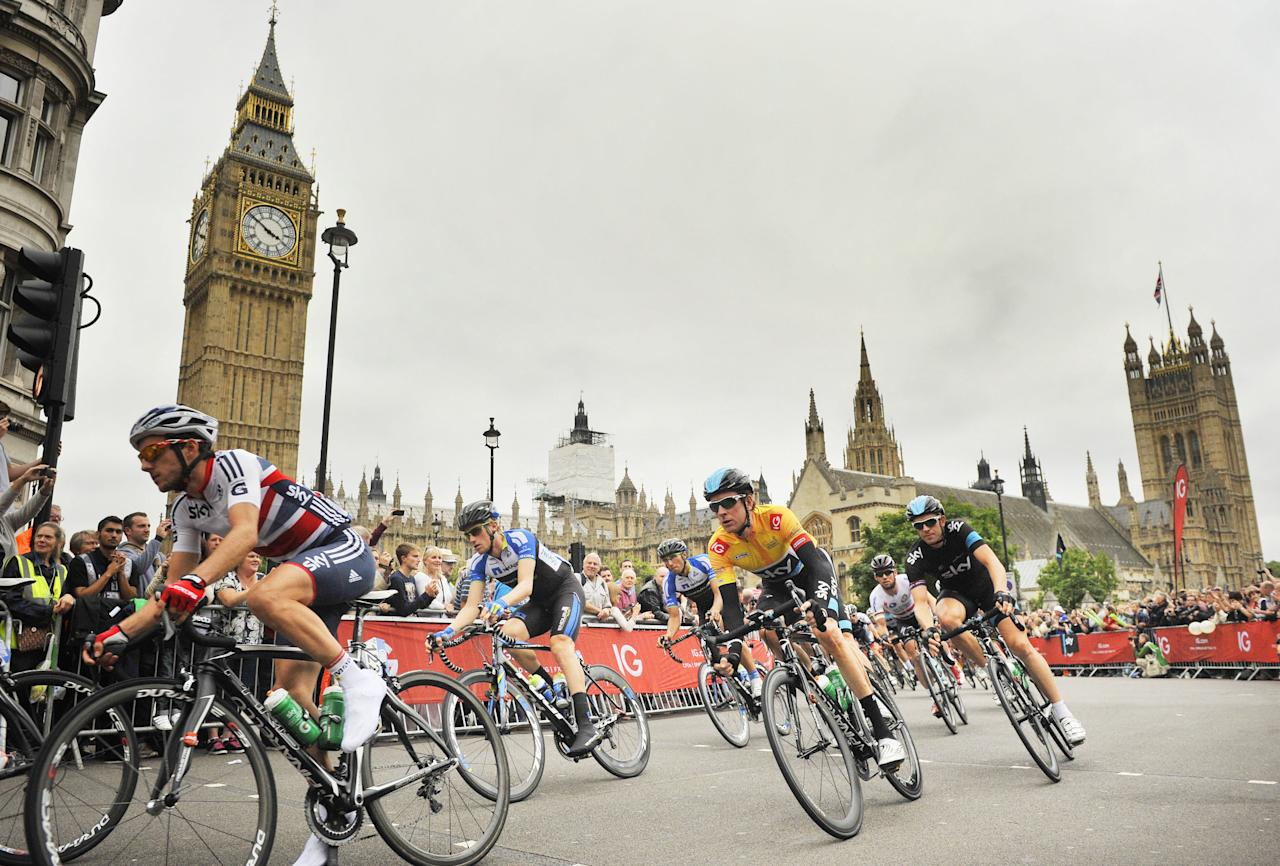 Team Sky's Sir Bradley Wiggins passes the Houses of Parliament during stage eight of the 2013 Tour of Britain in London.