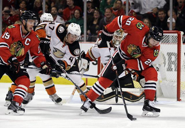 Chicago Blackhawks left wing Brandon Saad (20) gains control of the puck against the Anaheim Ducks during the second period of Game 3 of the Western Conference finals in the NHL hockey Stanley Cup playoffs, Thursday, May 21, 2015, in Chicago. (AP Photo/Nam Y. Huh)