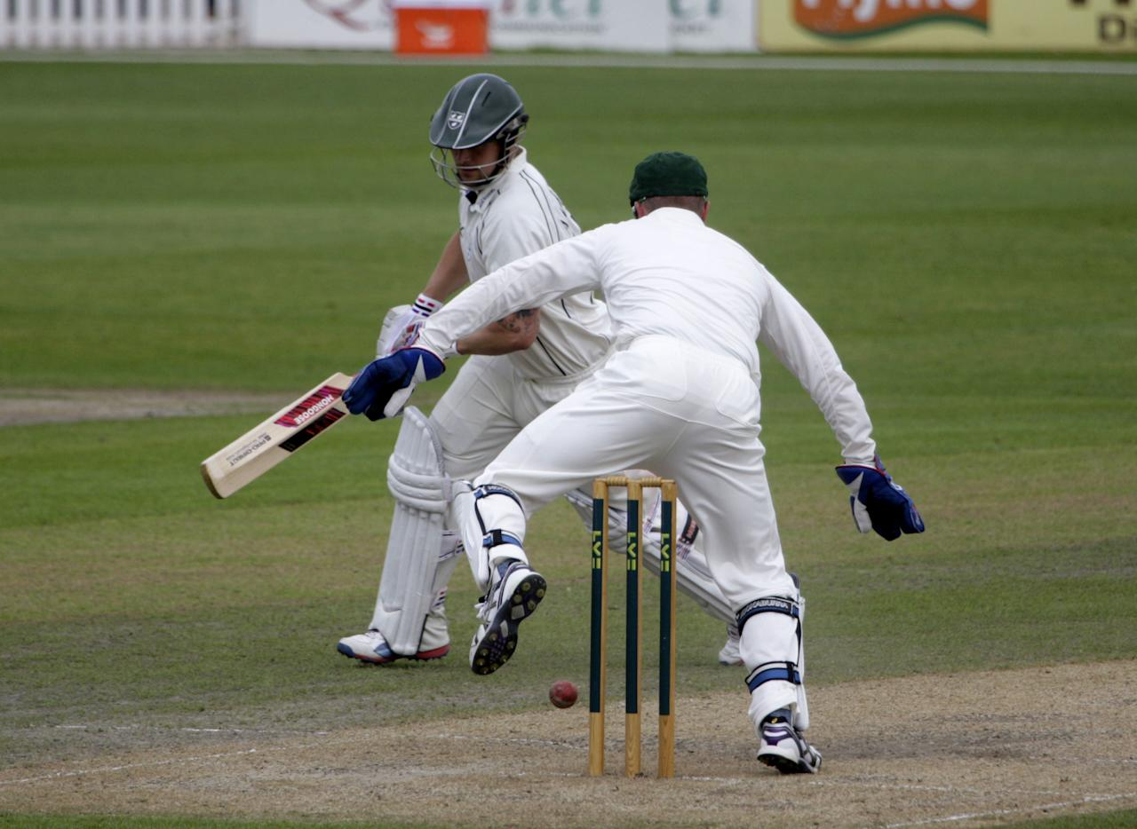 Australia's Brad Haddin hurdles the stumps to retrieve the ball during day two of the International Warm up match at New Road, Worcester.