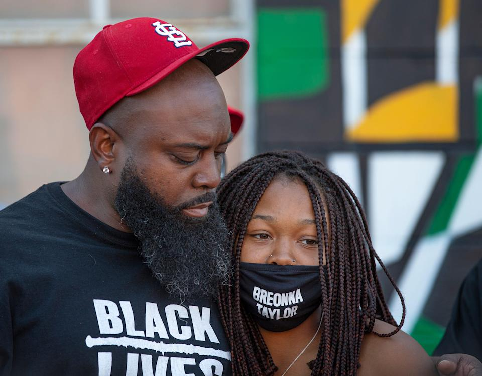 Michael Brown Sr. hugs Ju'Niyah Palmer at the Until Freedom rally Louisville, Kentucky on Aug. 8, 2020. Both lost loved ones in police shootings: Michael Brown Jr. in Ferguson, Missouri in 2014 and Breonna Taylor in March 2020.