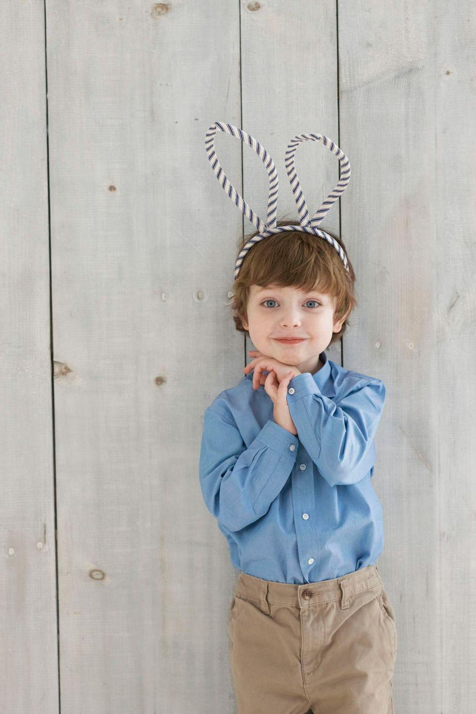 <p>To stitch up one of these kid-friendly accessories, you'll need a child-size headband and 11⁄2 yards of 1⁄2-inch-wide double- fold bias tape.</p><p><strong>Step 1</strong>: Cut an 18.5-inch-long piece of bias tape. Hem the cut ends under 1⁄2 inch on each side, then stitch together the long side to form a casing. Fold the casing in half so that the ends touch and use a straight pin to mark the fold's center.</p><p><strong>Step 2</strong>: Feed an extra-thick, 12-inch-long pipe cleaner through one end of the casing, stopping at the pin. Feed a second pipe cleaner through the casing's other end until it, too, meets the pin; remove pin. Bring the casing's open ends toward each other and twist the exposed pipe cleaners together to form a rabbit ear shape. Repeat steps one and two to make a second ear.</p><p><strong>Step 3</strong>: Cut a piece of bias tape the length of the headband, plus one extra inch. Wrap the tape over the headband, then use pins to mark the two spots where you want to attach the ears (use the photo at left for guidance).</p><p><strong>Step 4</strong>: Remove the tape from the headband and stitch the long side together, from the pins out to both ends of the tape; stitch these ends closed, and remove pins. Twist the ears' pipe-cleaner ends around the headband in the desired spots, then slide each end of the headband into the casing. Use a needle and thread to slip-stitch the tape around and between the ears closed.</p>