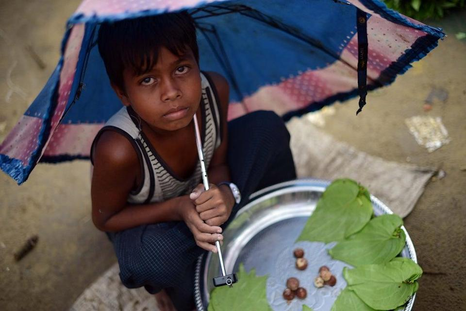 A boy selling betel leaves at a market at the Say Thamagyi Internally Displaced Persons (IDP) camp located on the outskirts of Sittwe, capital of Myanmar's western Rakhine state (AFP via Getty Images)