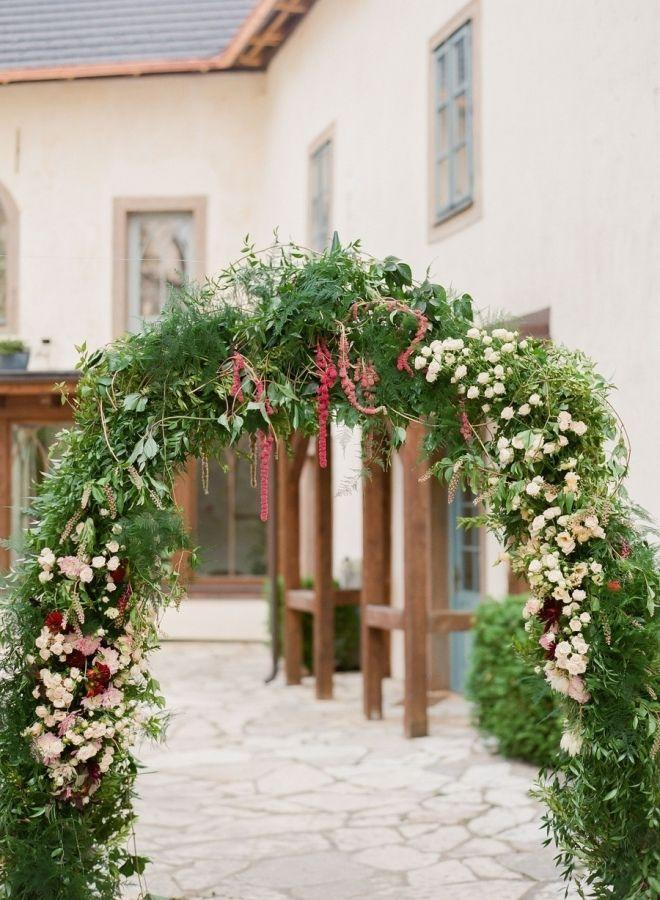 "<p>Give your Christmas party guests a grand entrance with an arching garland that sweeps them into a winter wonderland, as does this pretty arch from <a href=""http://www.stylemepretty.com/vault/image/3416712"" rel=""nofollow noopener"" target=""_blank"" data-ylk=""slk:Style Me Pretty Living"" class=""link rapid-noclick-resp"">Style Me Pretty Living</a>. </p>"