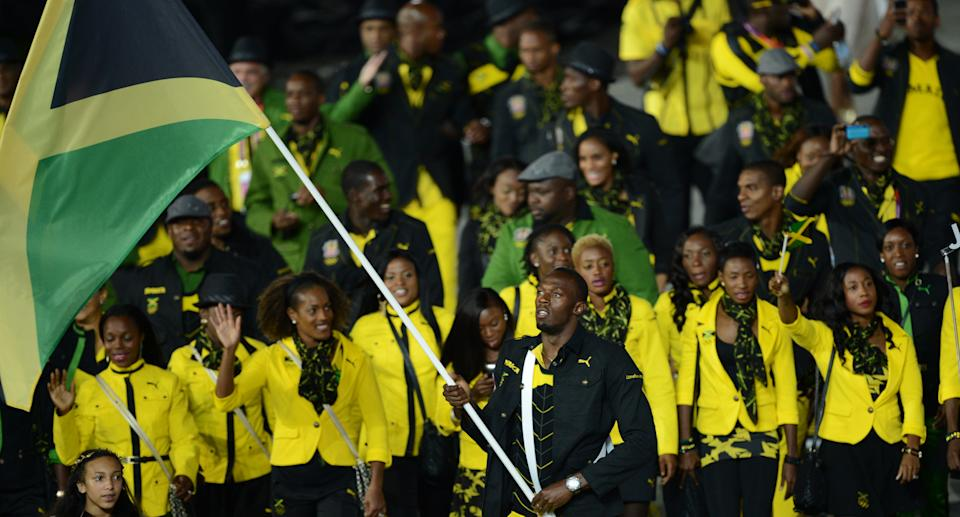 Jamaica's flagbearer Usain Bolt leads his delegation during the opening ceremony of the London 2012 Olympic Games in the Olympic Stadium in London on July 27, 2012.    AFP PHOTO / CHRISTOPHE SIMON        (Photo credit should read CHRISTOPHE SIMON/AFP/GettyImages)