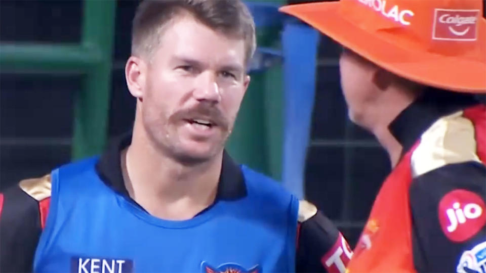 David Warner, pictured here speaking to Trevor Bayliss during Sunrisers Hyderabad's loss to Rajasthan Royals.