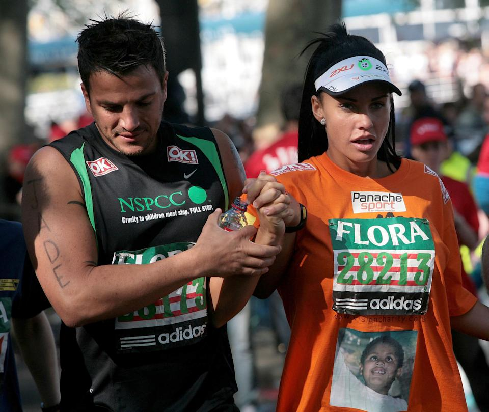 Katie Price continues with Peter Andre after her knee buckled during the 2009 Flora London Marathon.