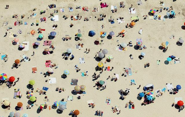 Scorching heat waves swept across the U.S., topping records and sending many to beaches for a reprieve. The U.N.'s World Meteorological Organization concluded 2012 will be one of the warmest years on record. (Mario Tama/Getty Images)