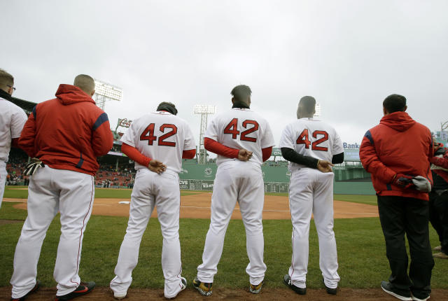 Members of the Boston Red Sox wear No. 42 jerseys while standing on the baseline during the playing of the national anthem on Major League Baseball's annual Jackie Robinson Day, Sunday, April 15, 2018, before a game against the Baltimore Orioles, in Boston. (AP Photo/Steven Senne)