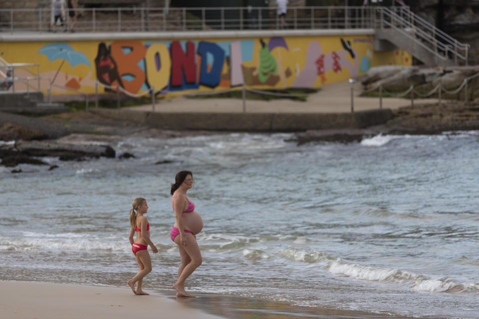 SYDNEY, AUSTRALIA - APRIL 28: A pregnant swimmer returns to Bondi beach on April 28, 2020 in Sydney, Australia. Waverley Council reopened Bondi, Bronte and Tamarama beaches today, with COVID-19 social distancing rules still in place. The beaches will be open from 7am to 5pm for swimmers and surfers on weekdays, but will remain closed on weekends. Several beaches in Sydney's Eastern suburbs were closed March 28, after large crowds were seen gathering at Bondi Beach despite social distancing orders in place to slow the spread of COVID-19. (Photo by Brook Mitchell/Getty Images)