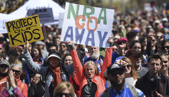 """FILE - In this March 24, 2018, file photo, crowds of people participate in the March for Our Lives rally in support of gun control in San Francisco. The National Rifle Association sued San Francisco on Monday, Sept. 9, 2019, over the city's recent declaration that the gun-rights lobby is a """"domestic terrorist organization."""" (AP Photo/Josh Edelson, File)"""
