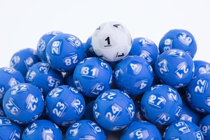 Blue lottery balls and the all-important white Powerball are pictured.