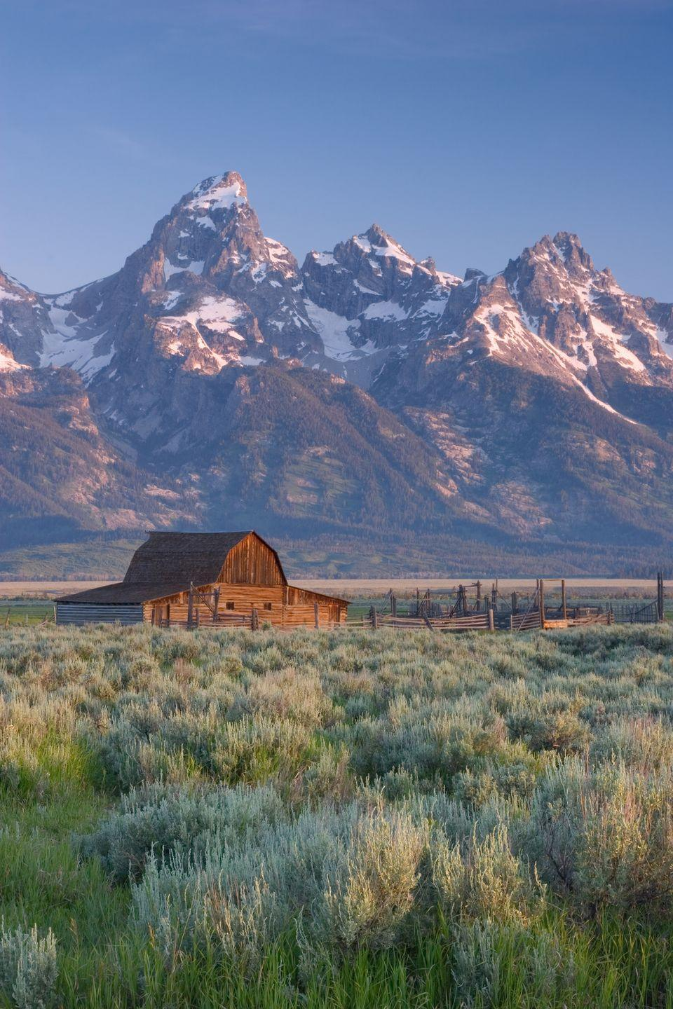 """<p><strong>Where: </strong>Grand Teton, Wyoming</p><p><strong>Why We Love It: </strong>This mountain is so beautiful that it had an entire national park named after it.</p><p><strong>RELATED:</strong> <a href=""""https://www.countryliving.com/life/travel/g4206/americas-best-small-mountain-towns/"""" rel=""""nofollow noopener"""" target=""""_blank"""" data-ylk=""""slk:Small Mountain Towns Perfect for a Summer Vacation"""" class=""""link rapid-noclick-resp"""">Small Mountain Towns Perfect for a Summer Vacation</a></p>"""