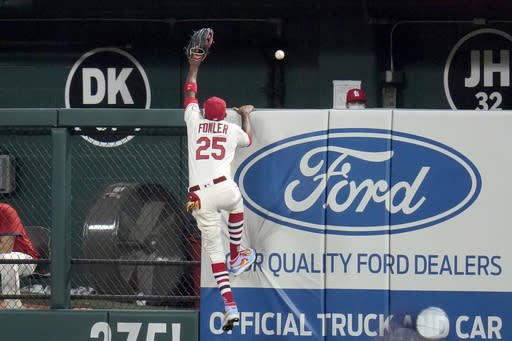 St. Louis Cardinals right fielder Dexter Fowler reaches for a solo home run by Milwaukee Brewers' Ryan Braun during the fourth inning of a baseball game Saturday, Sept. 26, 2020, in St. Louis. (AP Photo/Jeff Roberson)