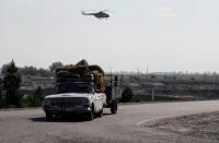 An Azerbaijani military helicopter flies during the fighting over the breakaway region of Nagorno-Karabakh near the city of Terter