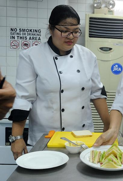 Rochelle Evaristo prepares to make a sandwich at a school run by the government's Technical Education and Skills Development Authority (TESDA) in Manila (AFP Photo/Jay Directo)
