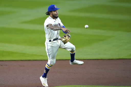 Seattle Mariners shortstop J.P. Crawford makes a running throw to first to get out Texas Rangers' Nick Solak on a ground out during the first inning of a baseball game, Sunday, Aug. 23, 2020, in Seattle. (AP Photo/Ted S. Warren)