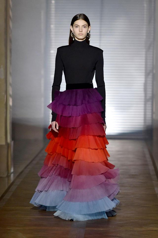 <p>Model wears a black turtleneck and multi-colored tier skirt from the Givenchy SS18 Haute Couture show. (Photo: Getty Images) </p>