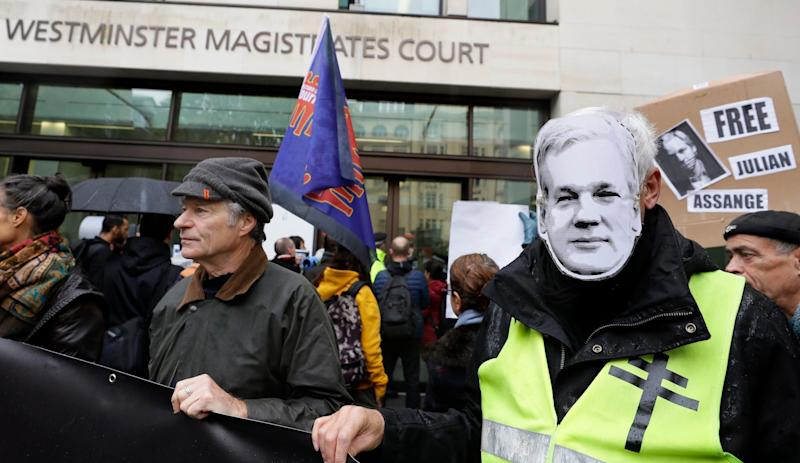 Those supporting Julian Assange, right, were outside court as the WikiLeaks founder appeared in the dock (AP)