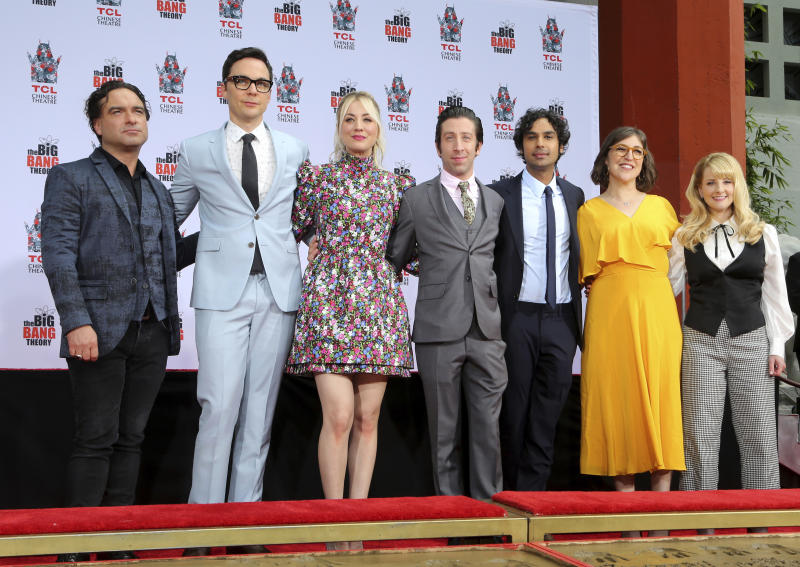 """FILE - In this May 1, 2019, file photo, Johnny Galecki, from left, Jim Parsons, Kaley Cuoco, Simon Helberg, Kunal Nayyar, Mayim Bialik and Melissa Rauch, cast members of the TV series """"The Big Bang Theory,"""" pose at a hand and footprint ceremony at the TCL Chinese Theatre in Los Angeles. """"The Big Bang Theory"""" made its way into the annals of the Nobel Prizes in real life. The announcement, Oct. 8, 2019, that a trio of scientists had won the physics Nobel started off with an unlikely reference: the opening lines of """"The Big Bang Theory."""" (Photo by Willy Sanjuan/Invision/AP, File)"""