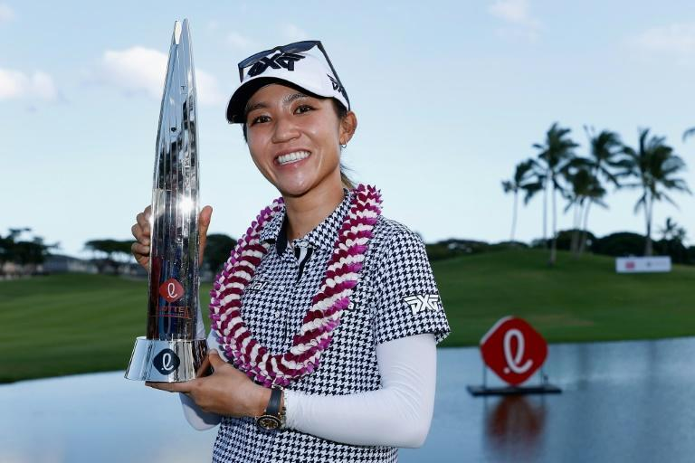 Lydia Ko celebrates winning the Lotte Championship in Hawaii, her first victory for 1,084 days