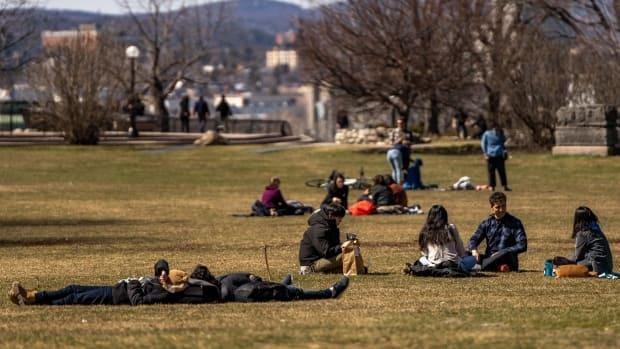 People soak up the sun in Major's Hill Park in Ottawa during the COVID-19 pandemic on Saturday, April 3, 2021. Masks could soon become mandatory in city parks as the third wave of COVID-19 threatens to overwhelm local hospitals. (Mathieu Theriault/CBC - image credit)