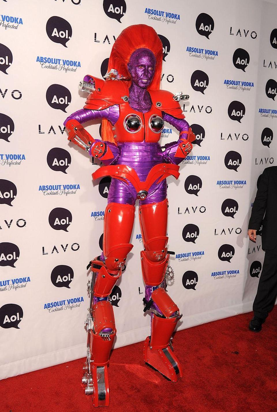 <p>'Go big or go home, right Heidi?' </p><p>In 2010, the businesswoman wore a superhero bot suit with purple shimmery glitter all over her body. </p>