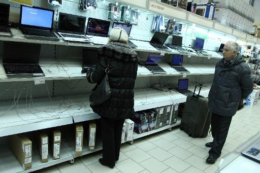 Belarus blocks online sites, closes stores to stem currency panic