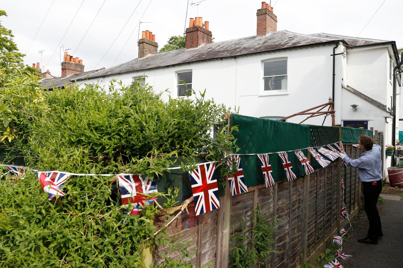 <p>Locals get into the spirit of things, hanging bunting on their garden fences. [Photo: Getty] </p>
