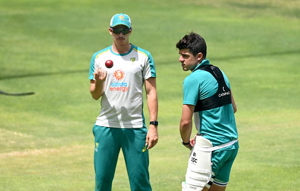Moises Henriques and Sean Abbott talk tactics during an Australian Nets session at The Gabba on January 14, 2021 in Brisbane, Australia. (Photo by Bradley Kanaris/Getty Images)