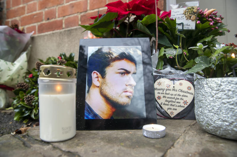 Floral tributes, candles and messages are left outside the home of George Michael in Goring-on-Thames, Oxfordshire, on the second anniversary of the singer's death.