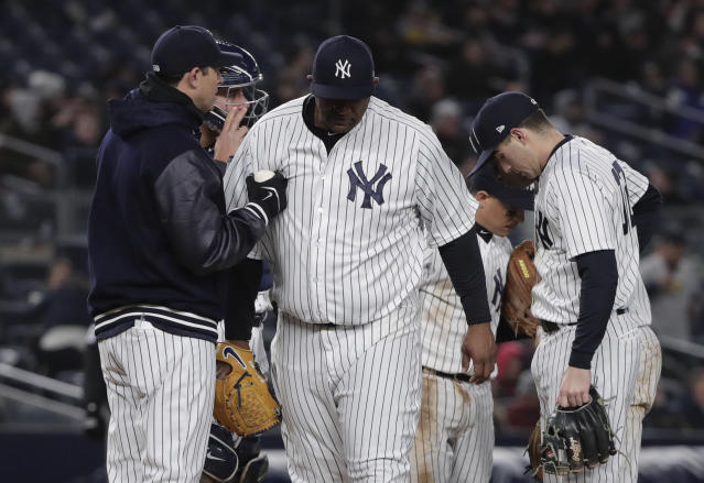 New York Yankees pitcher CC Sabathia walks off the mound as manager Aaron Boone relieves him during the fifth inning of a baseball game against the Toronto Blue Jays, Thursday, April 19, 2018, in New York. (AP Photo/Julie Jacobson)
