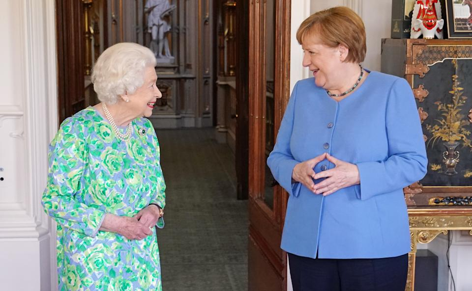 WINDSOR, ENGLAND - JULY 2: Queen Elizabeth II receives the Chancellor of Germany, Angela Merkel, during an audience at Windsor Castle on July 2, 2021 in Windsor, England. Angela Merkel is in her final few months as German Chancellor announcing in 2018 that she would not seek a fifth term in September's elections.  (Photo by Steve Parsons- WPA Pool/Getty Images)